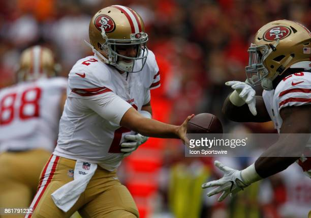 San Francisco 49ers quarterback Brian Hoyer prepares to hand the ball off to runningback Carlos Hyde during a football game between the San Francisco...