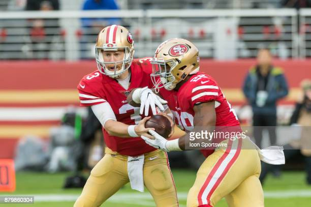 San Francisco 49ers quarterback CJ Beathard completes a handoff to San Francisco 49ers running back Carlos Hyde during the football game between...