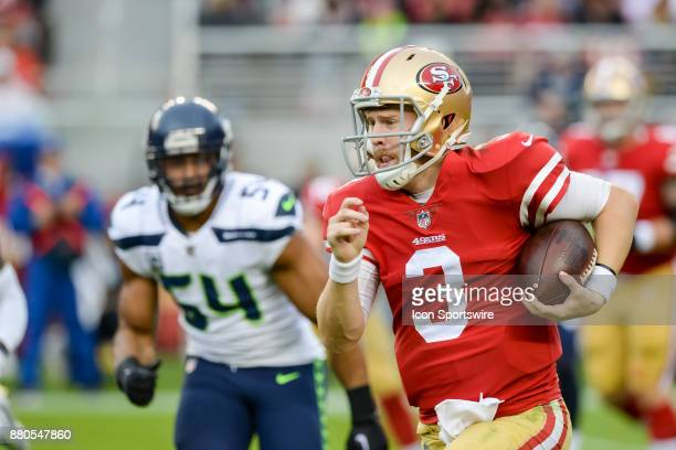 San Francisco 49ers quarterback CJ Beathard runs for positive yardage during Seattle Seahawks and San Francisco 49ers game on November 26 2017 at...