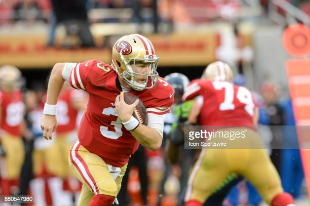 San Francisco 49ers quarterback CJ Beathard runs the ball for positive yards during Seattle Seahawks versus San Francisco 49ers game on November 26...