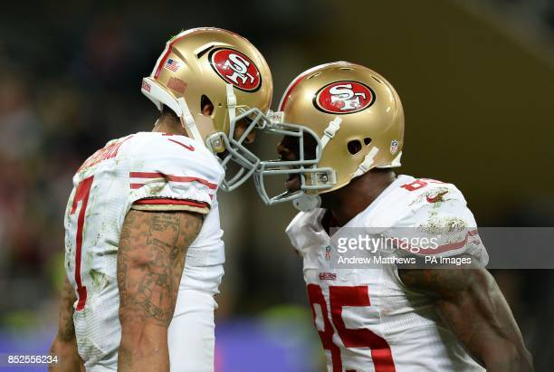San Francisco 49ers' quarterback Colin Kaepernick celebrates with team mate Vernon Davis after runs in to score his second touchdown during the NFL...