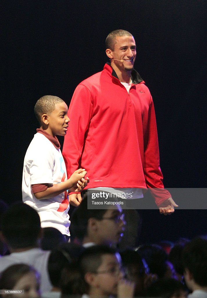 San Francisco 49ers quarterback <a gi-track='captionPersonalityLinkClicked' href=/galleries/search?phrase=Colin+Kaepernick&family=editorial&specificpeople=5525694 ng-click='$event.stopPropagation()'>Colin Kaepernick</a> enters the stage at McCormick Place during a debut of a school exercise program February 28, 2013 in Chicago, Ililnois. Michelle Obama unveiled a new program called 'Let's Move Active Schools' to help schools create a physical activity programs for students
