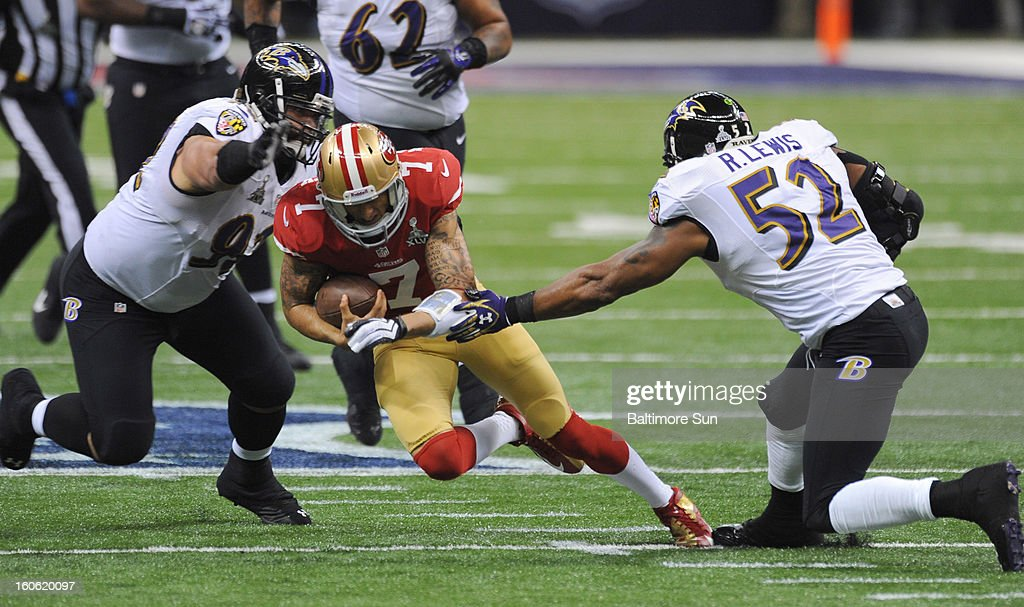 San Francisco 49ers quarterback Colin Kaepernick (7) finds a hole between the Baltimore Ravens' Haloti Ngata (92) and Ray Lewis (52) during Super Bowl XLVII at the Mercedes-Benz Superdome in New Orleans, Louisiana, Sunday, February 3, 2013.