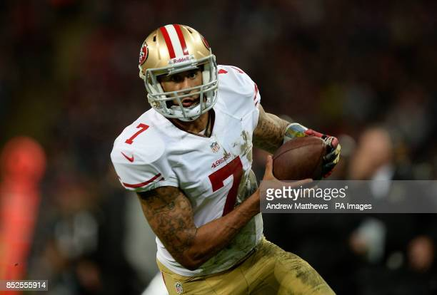 San Francisco 49ers' quarterback Colin Kaepernick runs in to score his side's second touchdown during the NFL International match at Wembley Stadium...