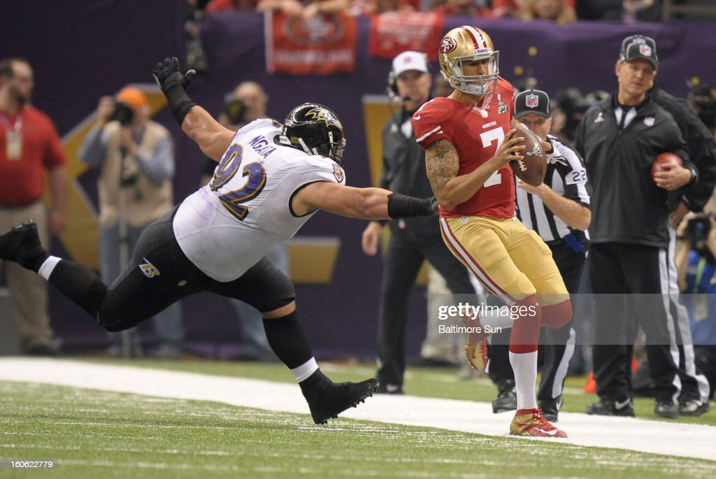 San Francisco 49ers quarterback Colin Kaepernick (7) runs out of bounds with Baltimore Ravens' Haloti Ngata in pursuit in the third quarter during Super Bowl XLVII at the Mercedes-Benz Superdome in New Orleans, Louisiana, Sunday, February 3, 2013.