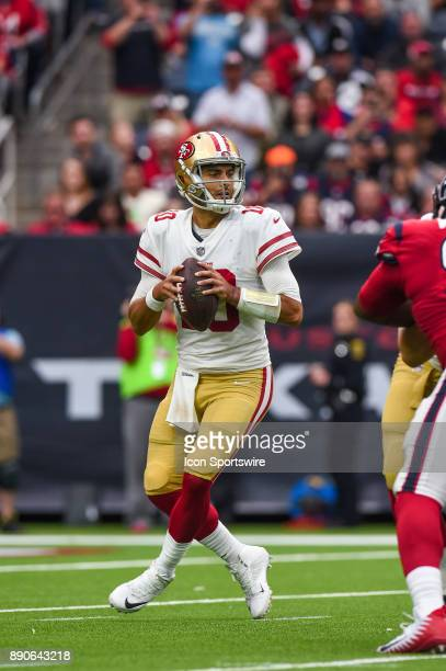 San Francisco 49ers quarterback Jimmy Garoppolo drops back to pass during the football game between the San Francisco 49ers and the Houston Texans on...