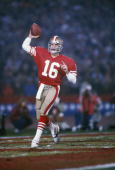 San Francisco 49ers quarterback Joe Montana looks to pass against the Miami Dolphins during Super Bowl XIX at Stanford Stadium on January 20 1985 in...