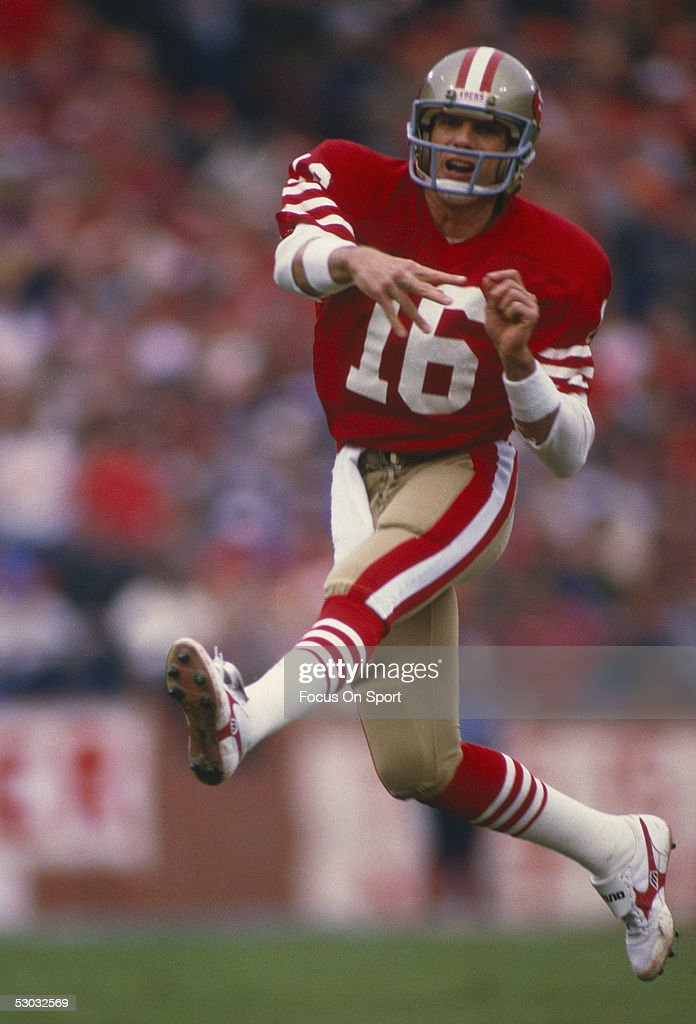 San Francisco 49ers' quarterback Joe Montana runs and passes during a game against the Miami Dolphins at Candlestick Park circa the 1980's in San...