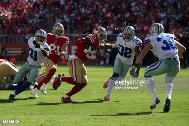 San Francisco 49ers running back Carlos Hyde about to be tackled by Dallas Cowboys strong safety Jeff Heath and cornerback Orlando Scandrick during...