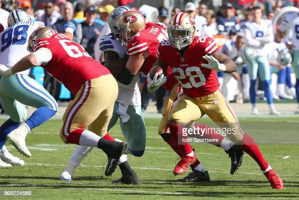 San Francisco 49ers running back Carlos Hyde finds an opening during an NFL game against the Dallas Cowboys on October 22 2017 at Levi's Stadium in...