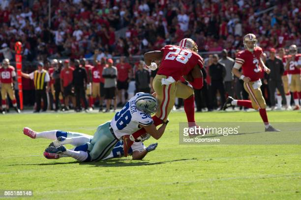 San Francisco 49ers running back Carlos Hyde tackled by Dallas Cowboys strong safety Jeff Heath and cornerback Orlando Scandrick during the first...