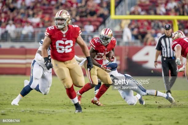San Francisco 49ers Running Back Tim Hightower runs through a hole created by San Francisco 49ers Offensive Lineman Erik Magnuson during a preseason...