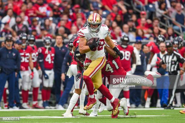 San Francisco 49ers tight end Garrett Celek runs the ball during the football game between the San Francisco 49ers and the Houston Texans on December...