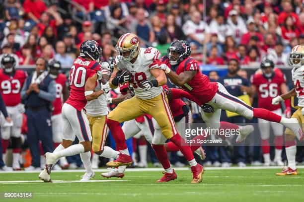 San Francisco 49ers tight end Garrett Celek takes Houston Texans inside linebacker Zach Cunningham for a ride during the football game between the...