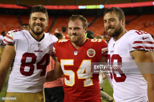 San Francisco 49ers tight ends Blake Bell and Garrett Celek pose for a picture with Kansas City Chiefs linebacker Marcus Rush after an NFL week 1...