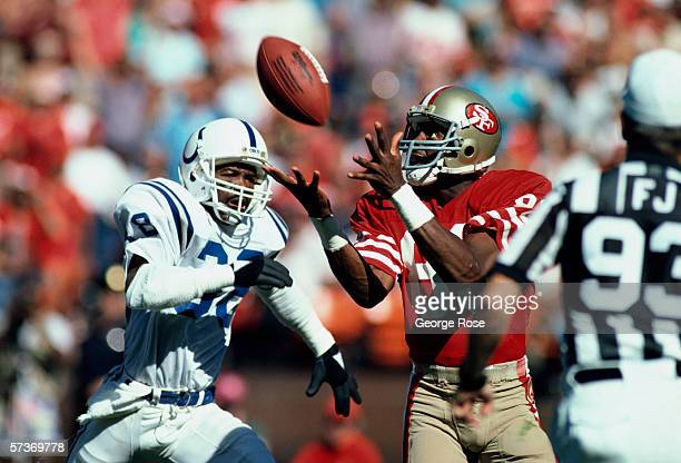 San Francisco 49ers wide receiver Jerry Rice hauls in a pass from Quarterback Joe Montana in a 1986 game against the Indianapolis Colts at...