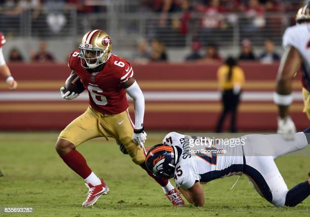 San Francisco 49ers Wide Receiver Kendrick Bourne avoids a tackle by Denver Broncos linebacker Kyle Snyder during an NFL preseason game between the...