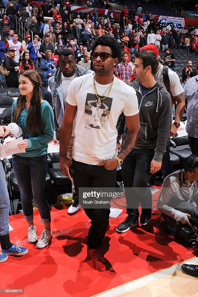 San Francisco 49ers wide receiver Michael Crabtree leaves the court following a game between the Detroit Pistons and the Los Angeles Clippers at Staples Center on March 10, 2013 in Los Angeles, California.