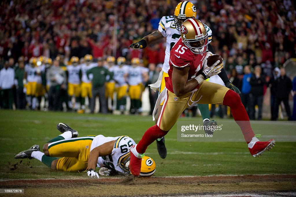 San Francisco 49ers wide reciever Michael Crabtree gets past the Green Bay Packers' Brad Jones for an 18-yard touchdown in the second quarter in the NFC Divisional Playoff on Saturday, January 12, 2013, at Candlestick Park in San Francisco, California.