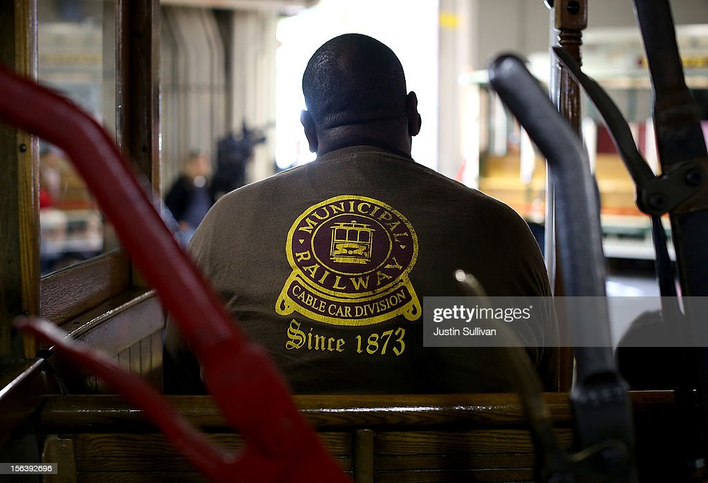 A San Francisco Cable Car gripman looks on during a service inauguration ceremony for a newly restored vintage Cable Car on November 14, 2012 in San Francisco, California. A service inauguration ceremony kicked off a new life for San Francisco Cable Car #26 that was originally built in 1890 and has been fully restored by hand and put back in service on the streets of San Francisco.
