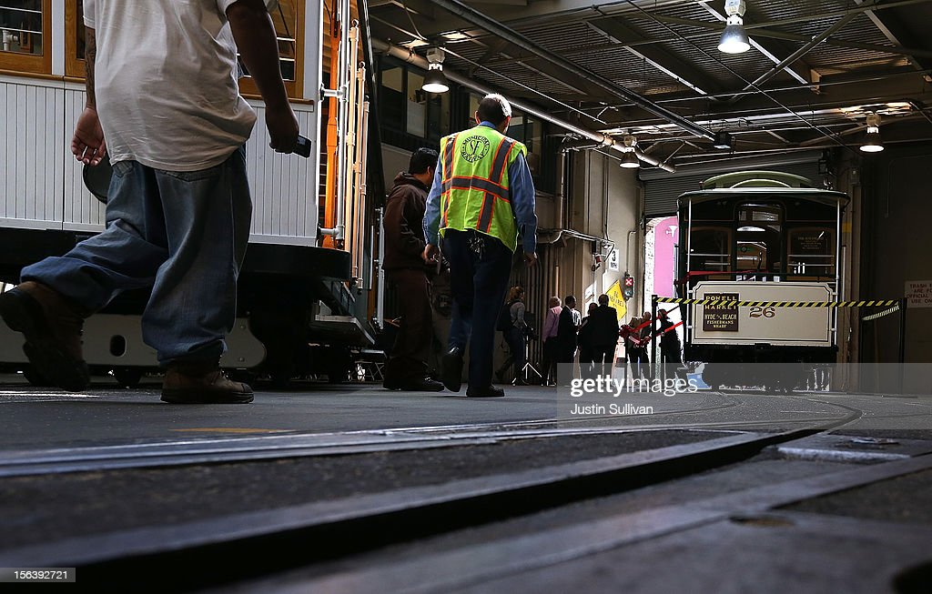 San Francisco Cable Car #26 prepares to roll out of the barn during a service inauguration ceremony for the newly restored vintage Cable Car on November 14, 2012 in San Francisco, California. A service inauguration ceremony kicked off a new life for San Francisco Cable Car #26 that was originally built in 1890 and has been fully restored by hand and put back in service on the streets of San Francisco.