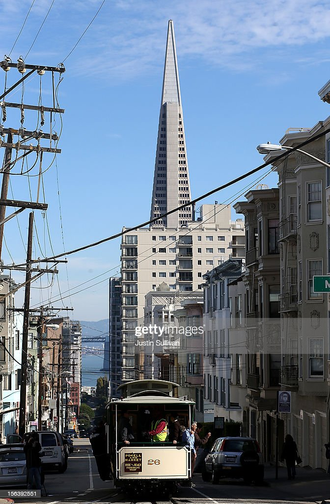 San Francisco Cable Car #26 travels along Washington Street after pulling out of the barn during a service inauguration ceremony for the newly restored vintage Cable Car on November 14, 2012 in San Francisco, California. A service inauguration ceremony kicked off a new life for San Francisco Cable Car #26 that was originally built in 1890 and has been fully restored by hand and put back in service on the streets of San Francisco.