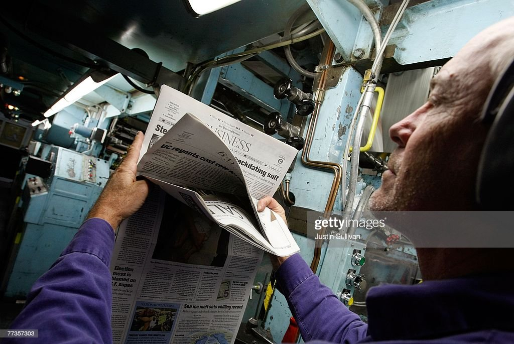 San Francisco Chronicle journeyman pressman Niel Nielsen inspects a copy of the Chronicle after it rolled off the printing press at one of the Chronicle's printing facilities September 20, 2007 in San Francisco, California. Newspaper sales in the U.S. continue to slide as people turn to the internet and television for their news. The Chronicle saw its circulation plunge more than 15 percent in 2006 to 398,000 during the week which has hurt newspaper vendor Rick Gaub's business. Unable to sell as many papers as he used to, Gaub is looking for a new way to earn money after selling papers for 42 years.