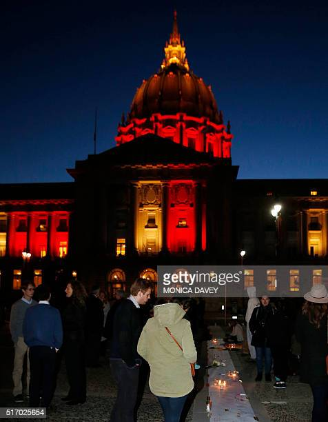 San Francisco City Hall is lit with the colors of the Belgian flag as supporters for the victims of the Brussels terrorist attacks show their...