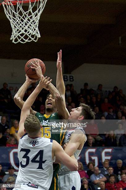 San Francisco Dons forward Nate Renfro defended under the basket by St Mary's Gaels center Jock Landale and St Mary's Gaels forward Dane Pineau...
