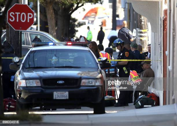 San Francisco firefighters work a triage area at the scene of a shooting at a company facility on June 14 2017 in San Francisco California A gunman...