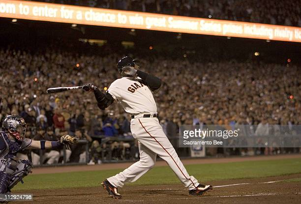 San Francisco Giants' Barry Bonds follows through on his swing for his recordsetting 756th home run in the fifth inning against the Washington...