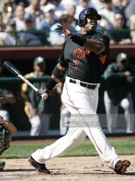 San Francisco Giants Barry Bonds grimaces after swinging and missing in Cactus League action vs the Oakland A's at Scottsdale Stadium in Scottsdale...