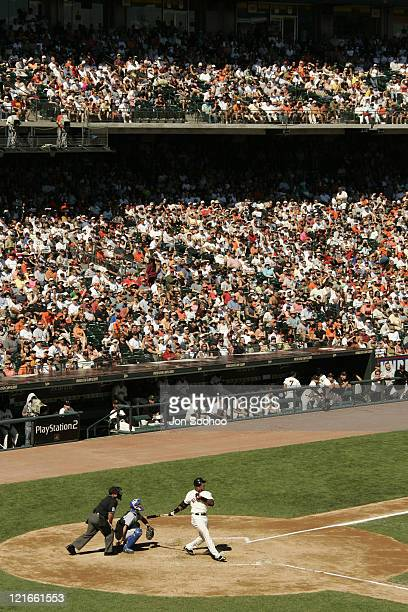 San Francisco Giants Barry Bonds hits his 703rd home run off Los Angeles Dodgers Jeff Weaver in the third inning Sunday September 26 2004 at SBC Park...