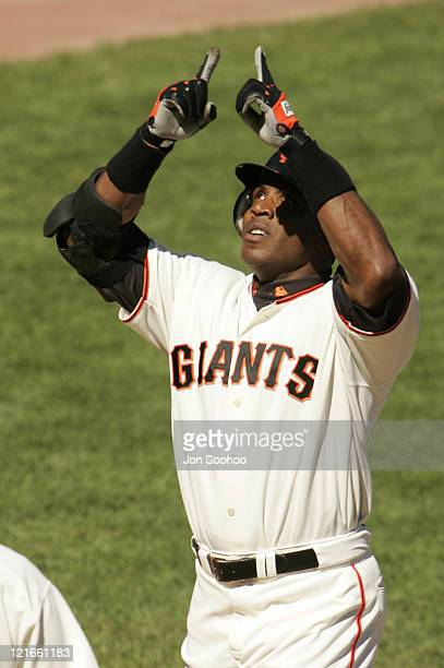 San Francisco Giants Barry Bonds points to the sky after hitting his 703rd home run in the 3rd inning off Los Angeles Dodger Jeff Weaver Sunday...