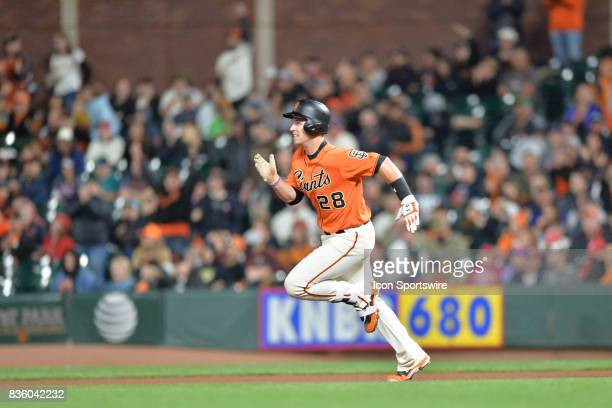 San Francisco Giants Catcher Buster Posey runs towards second base during the San Francisco Giants versus Philadelphia Phillies game at ATT Park on...