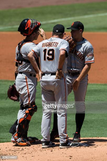 San Francisco Giants catcher Buster Posey San Francisco Giants pitching coach Dave Righetti and San Francisco Giants starting pitcher Ty Blach during...