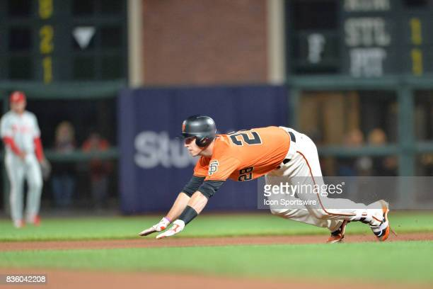 San Francisco Giants Catcher Buster Posey slides into second base during the San Francisco Giants versus Philadelphia Phillies game at ATT Park on...