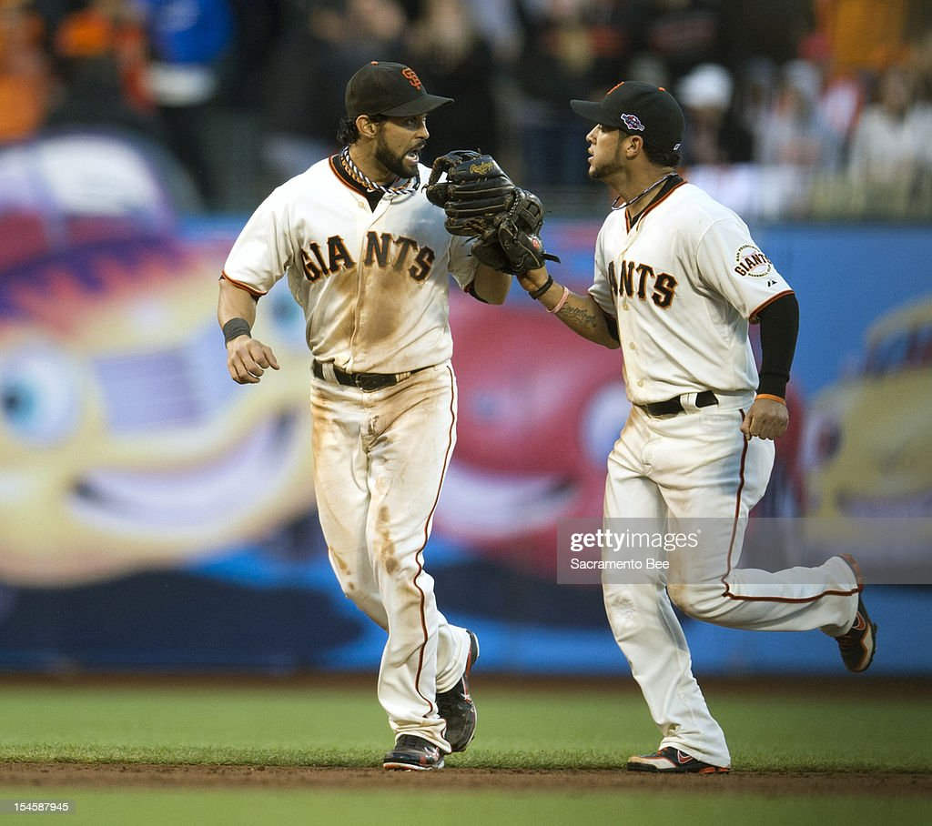 San Francisco Giants center fielder Angel Pagan (16) and San Francisco Giants right fielder Gregor Blanco (7) celebrate in the third inning during Game 7 of Game 7 of the National League Championship Series between the St. Louis Cardinals and the San Francisco Giants at AT&T Park on Monday, October 22, 2012, in San Francisco, California.
