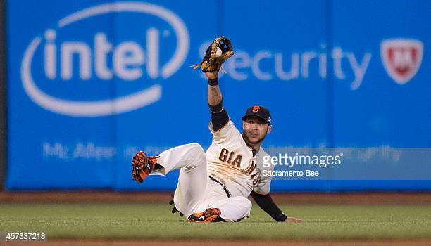 San Francisco Giants center fielder Gregor Blanco makes a sliding catch in the sixth inning against the St Louis Cardinals in Game 5 of the National...