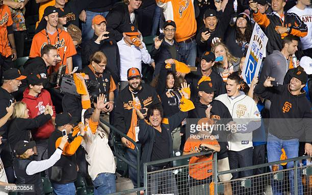 San Francisco Giants fan and lead singer of Journey Steve Perry sings along to 'Don't Stop Believin' during Game 3 of the 2014 World Series against...