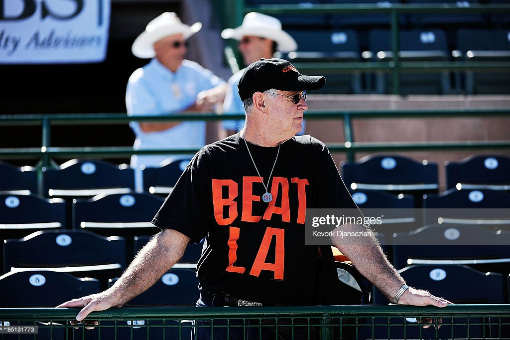 San Francisco Giants fan Dan Cohn wearing a 'Beat LA' tshirt waits for the start of a spring taining game against Los Angeles Dodgers at Scottsdale...