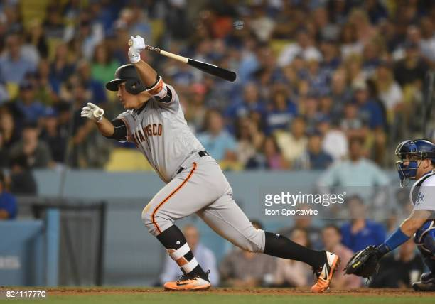 San Francisco Giants infielder JaeGyun Hwang hits for an RBI single in the seventh inning during a Major League Baseball game between the San...