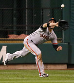 San Francisco Giants left fielder Travis Ishikawa catches a fly ball off the bat of the St Louis Cardinals' Yadier Molina to end the fourth inning...