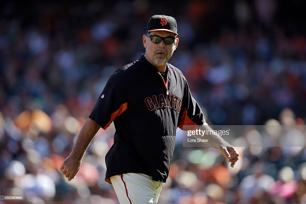 San Francisco Giants manager <a gi-track='captionPersonalityLinkClicked' href=/galleries/search?phrase=Bruce+Bochy&family=editorial&specificpeople=220291 ng-click='$event.stopPropagation()'>Bruce Bochy</a> walks back to the dugout during their game against the Milwaukee Brewers at AT&T Park on August 31, 2014 in San Francisco, California.