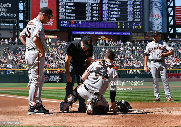 San Francisco Giants Manager Bruce Bochy watches as the trainer takes a look at San Francisco Giants Catcher Trevor Brown [11620] after getting hit...