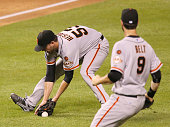 San Francisco Giants pitcher Chris Heston fails to cleanly field a sacrifice bunt by St Louis Cardinals' Michael Wacha during fifth inning action on...