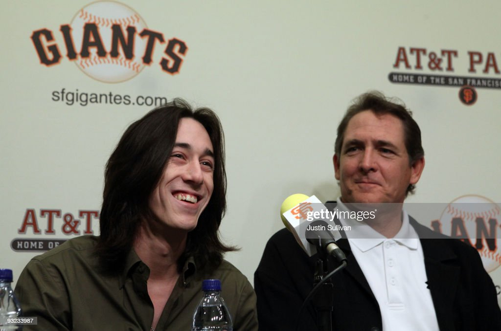 San Francisco Giants pitcher <a gi-track='captionPersonalityLinkClicked' href=/galleries/search?phrase=Tim+Lincecum&family=editorial&specificpeople=4175405 ng-click='$event.stopPropagation()'>Tim Lincecum</a> (L) smiles during a news conference as Giants pitching coach <a gi-track='captionPersonalityLinkClicked' href=/galleries/search?phrase=Dave+Righetti&family=editorial&specificpeople=210835 ng-click='$event.stopPropagation()'>Dave Righetti</a> looks on November 19, 2009 at AT&T Park in San Francisco, California. Lincecum won the Major League Baseball National League Cy Young award for the second consecutive year.