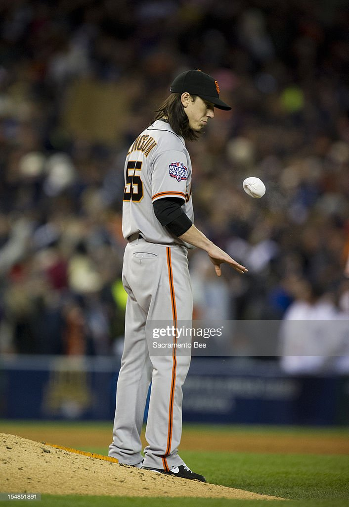 San Francisco Giants pitcher Tim Lincecum tosses the rosin bag in the seventh inning against the Detroit Tigers in Game 3 of the 2012 World Series at Comerica Park in Detroit, Michigan, on Saturday, October 27, 2012.