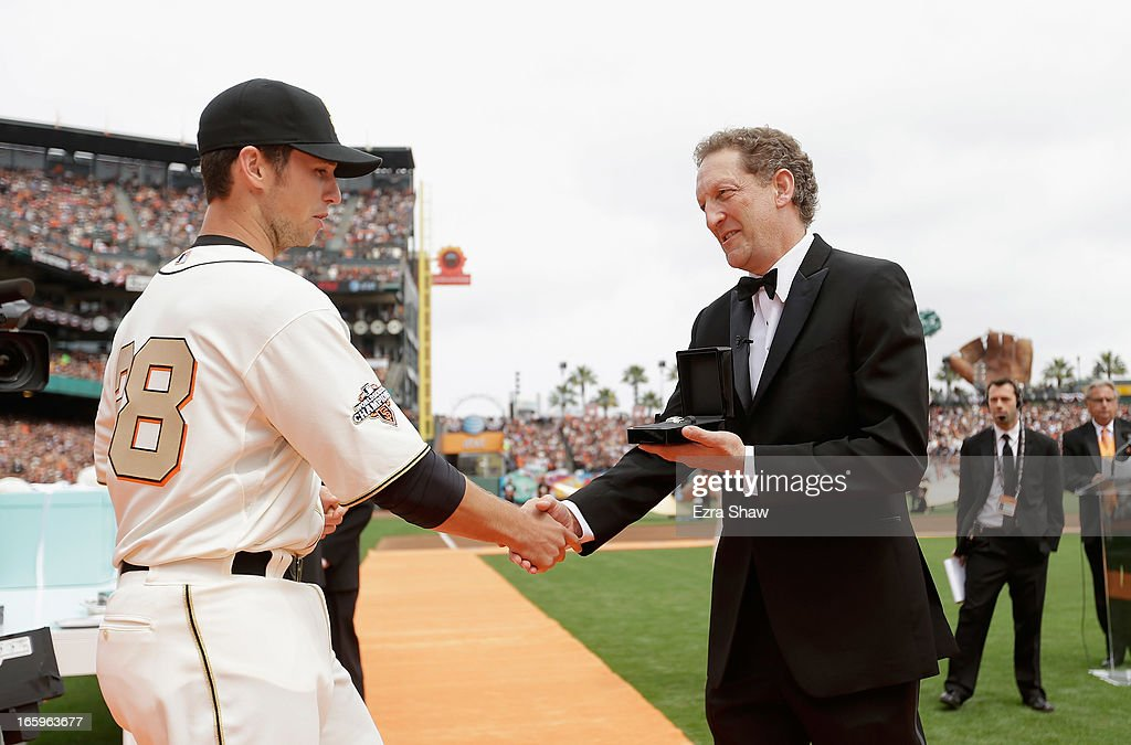 San Francisco Giants President and Chief Executive Officer Larry Baer gives Buster Posey #28 his 2012 Championship Ring during a pregame ceremony honoring the 2012 World Series champions before their game against the St. Louis Cardinals at AT&T Park on April 7, 2013 in San Francisco, California.