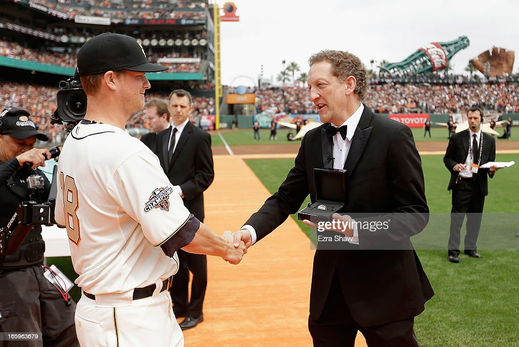 San Francisco Giants President and Chief Executive Officer Larry Baer gives Matt Cain #18 his 2012 Championship Ring during a pregame ceremony honoring the 2012 World Series champions before their game against the St. Louis Cardinals at AT&T Park on April 7, 2013 in San Francisco, California.